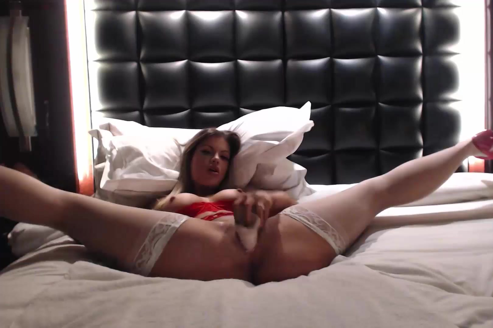 Hot blonde Harley LaVey filling her pussy with dildo on bed